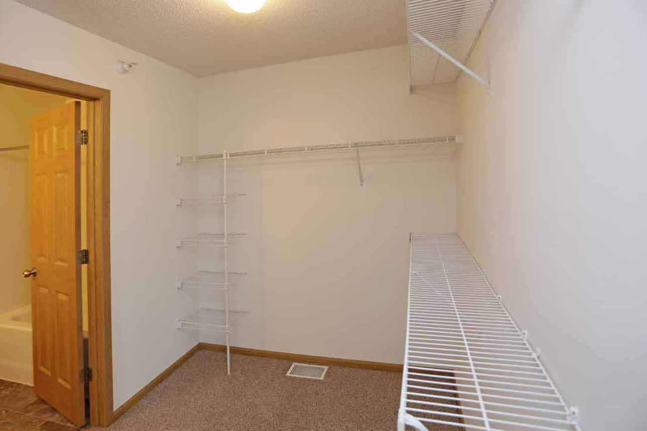 The Cedar (3 Bedroom): Shelving installed in all bedroom closets (all units)