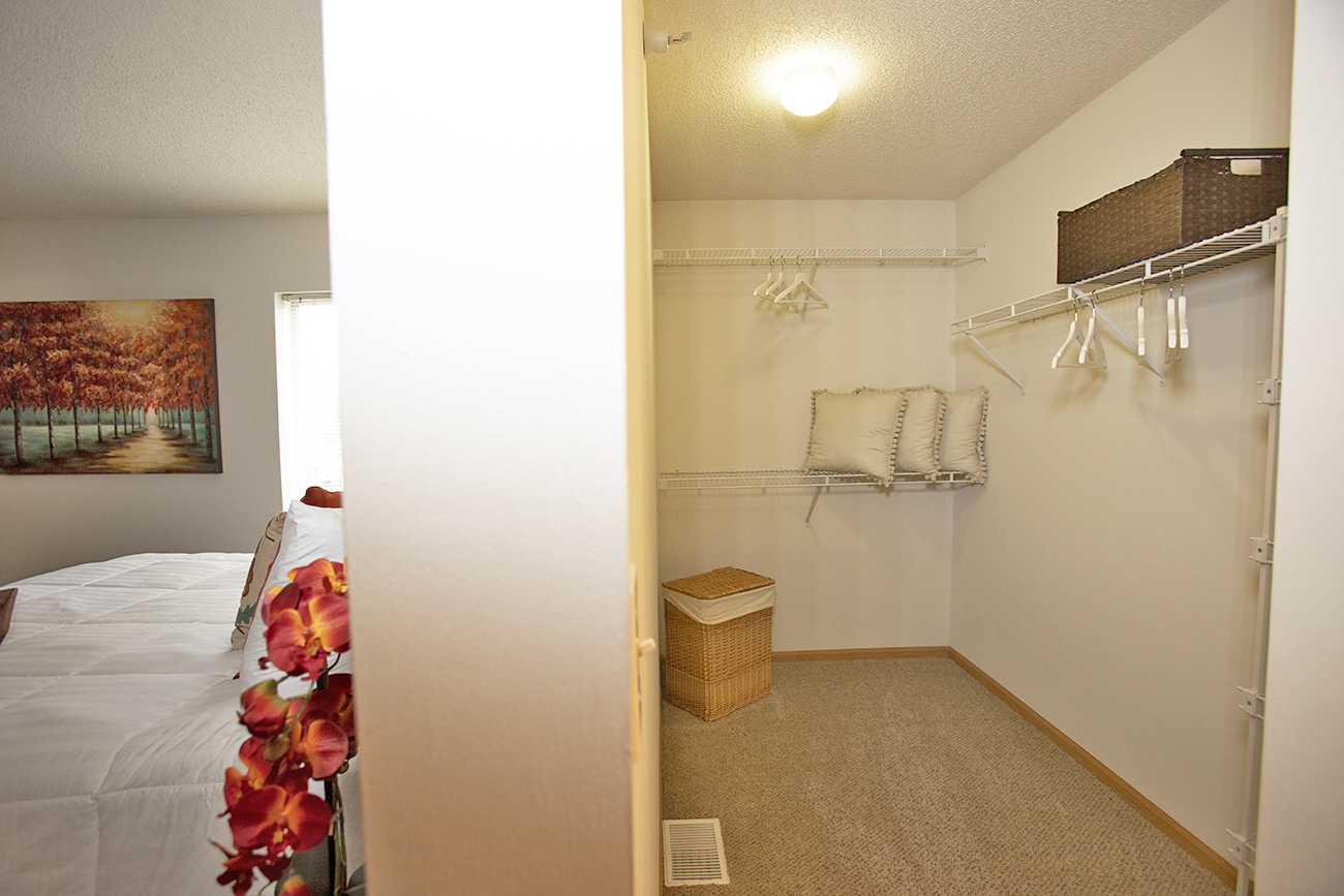 The Birch (2 bedroom): Main bedroom walk-in closet with built-in shelving