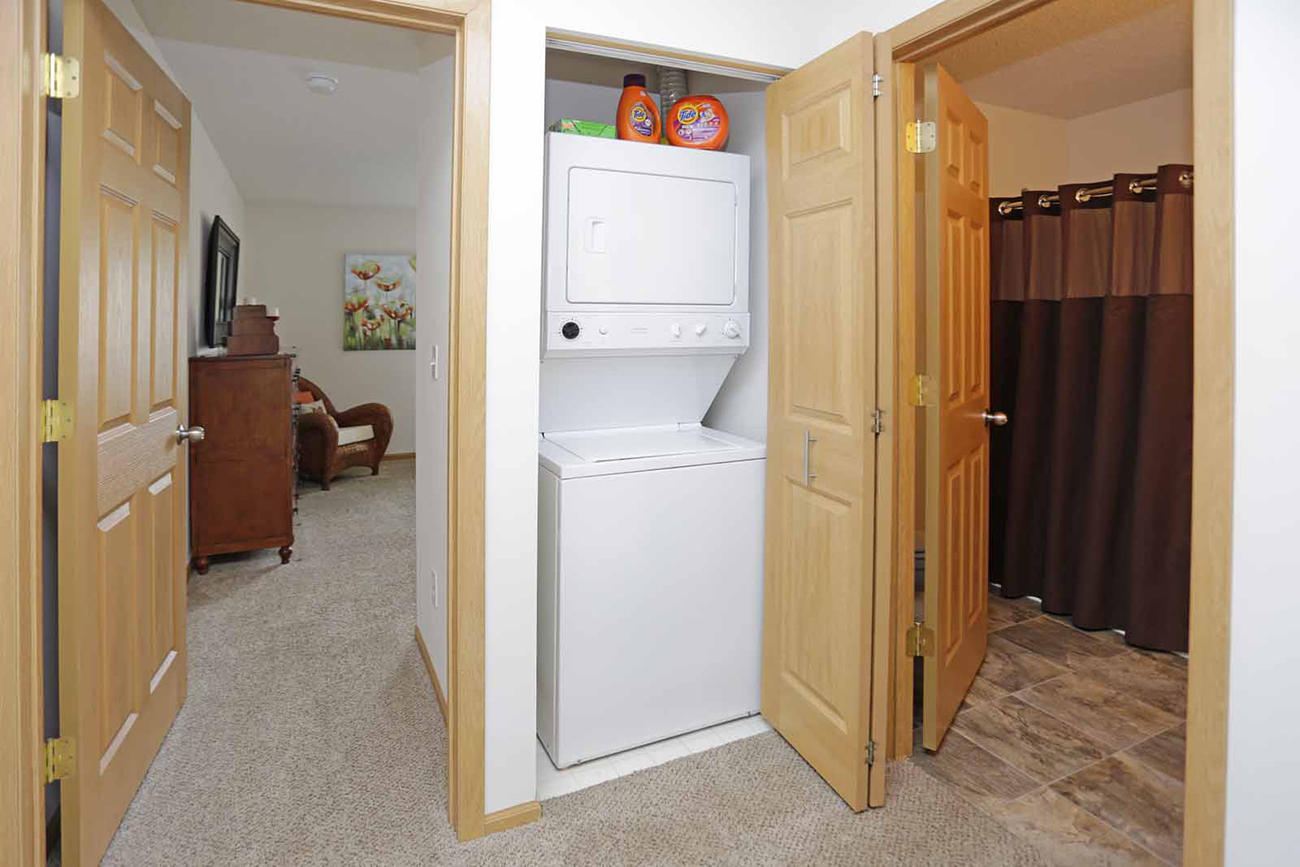 The Birch (2 Bedroom): Full-size washer and dryer in all units