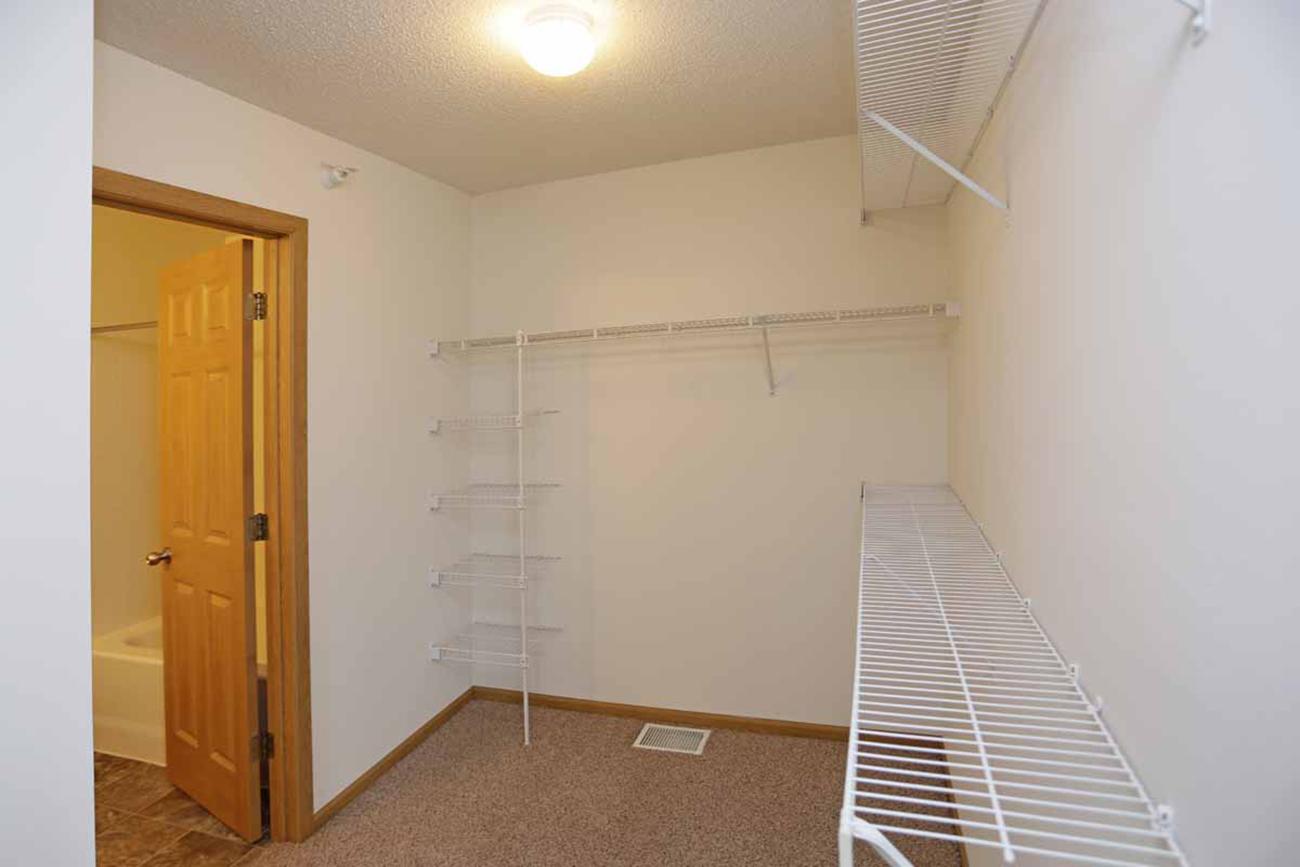 The Cedar (3 Bedroom): Shelving installed in all bedroom closets (all units)